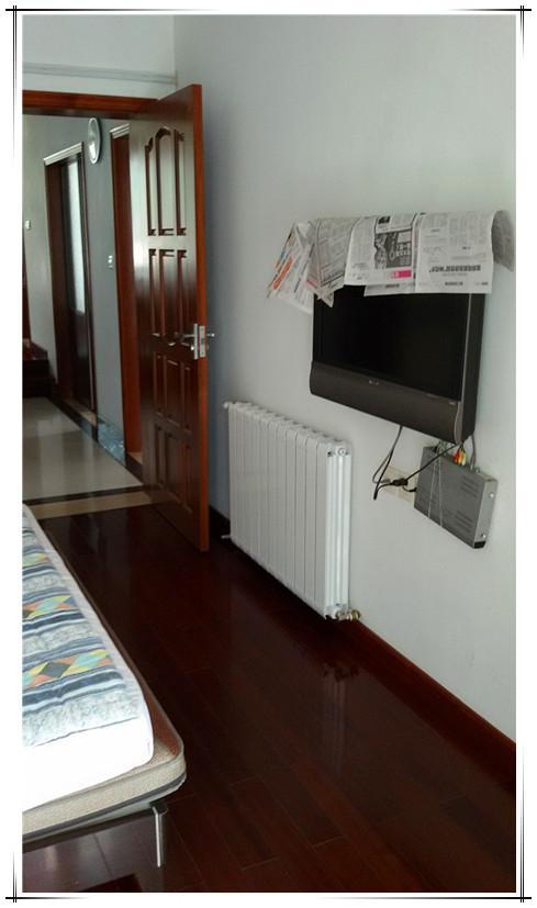 明管暖气片 已装修房子的采暖福利,一日完工,立享温暖高清图片